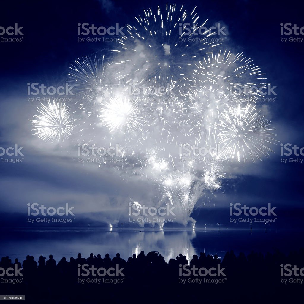 Large white and blue fireworks display stock photo