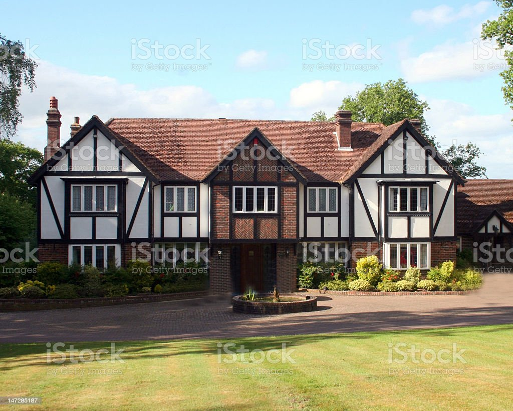 Large white and brown British Tudor house stock photo