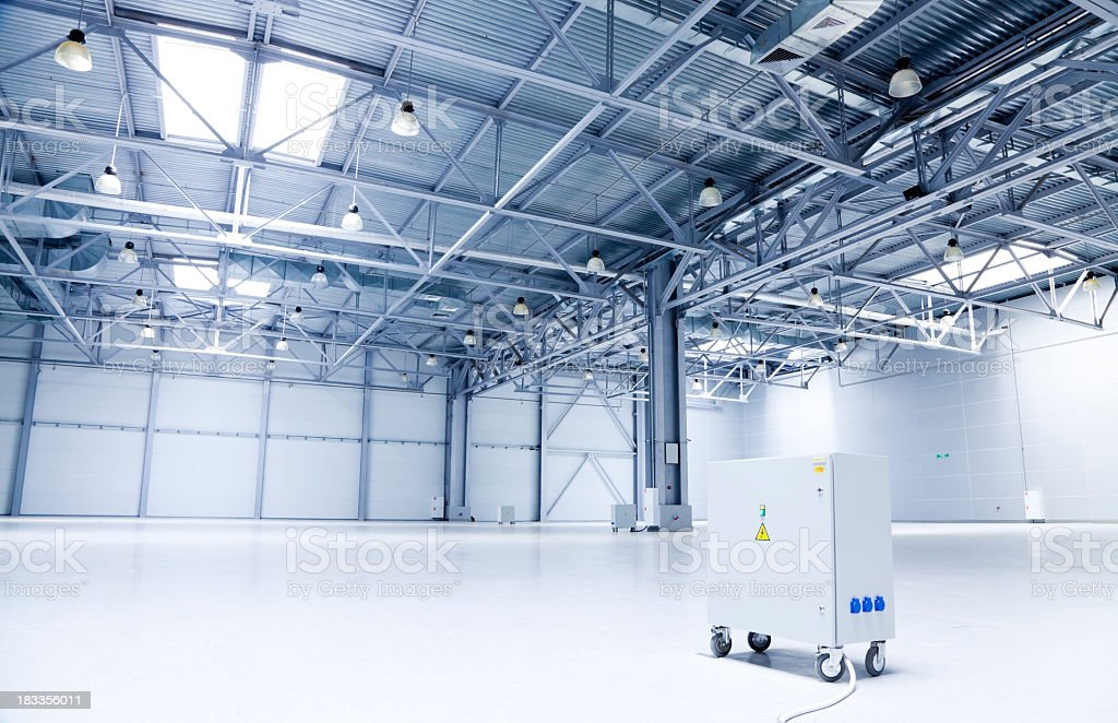 Large white and gray storehouse and one machine stock photo