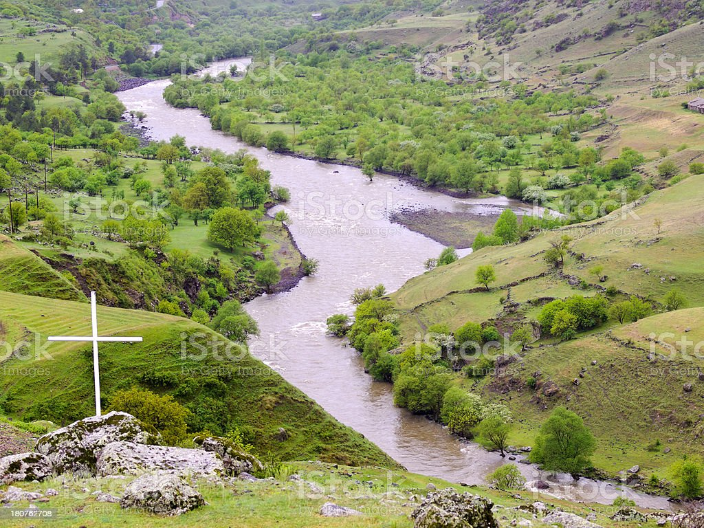 Large white cross on a rock above the River Kura. stock photo