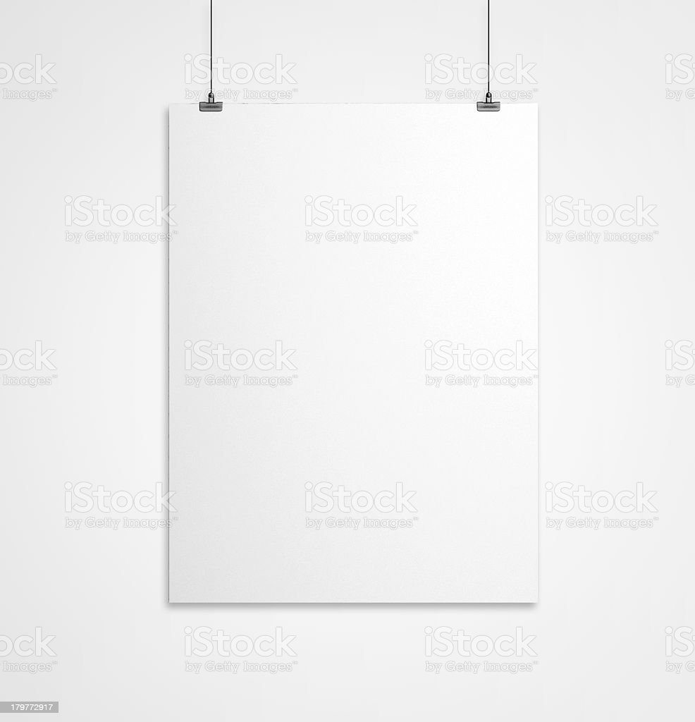 Large white sheet of paper hanging from the wall stock photo