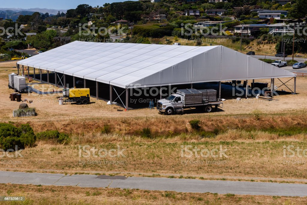 Large white tent for entertaining in field stock photo