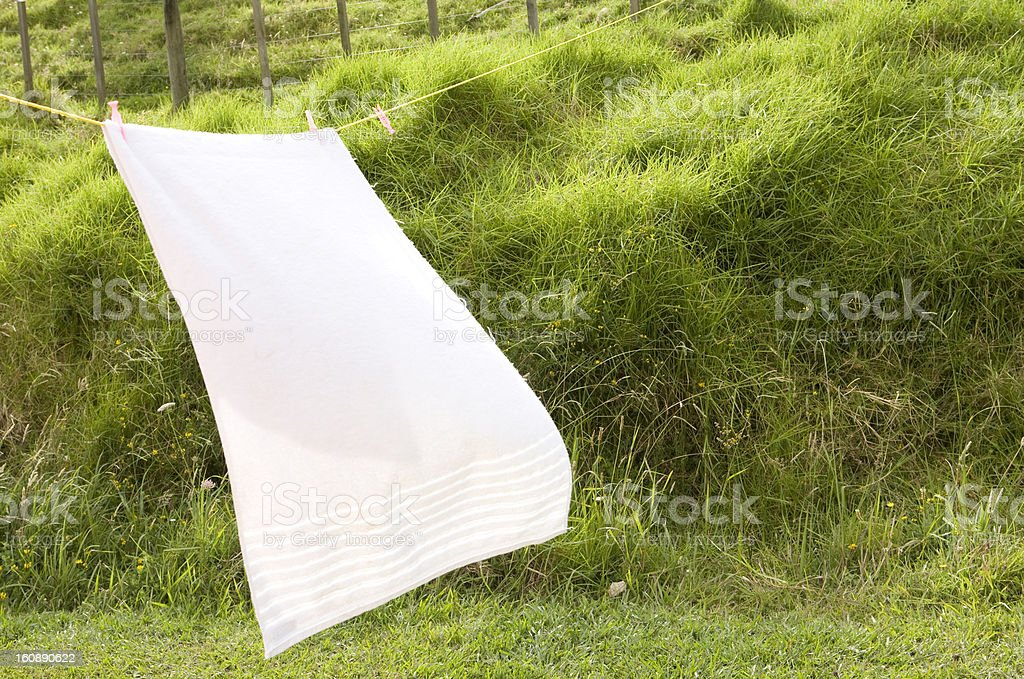 Large white towel blowing in the wind royalty-free stock photo