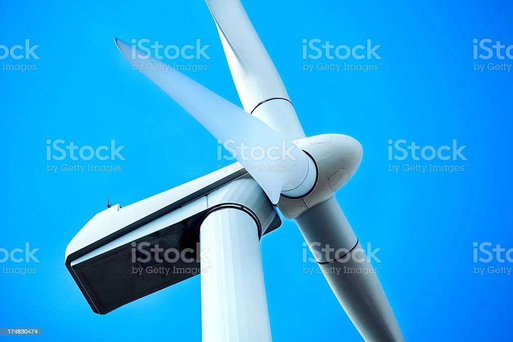 A large wind turbine in motion. stock photo