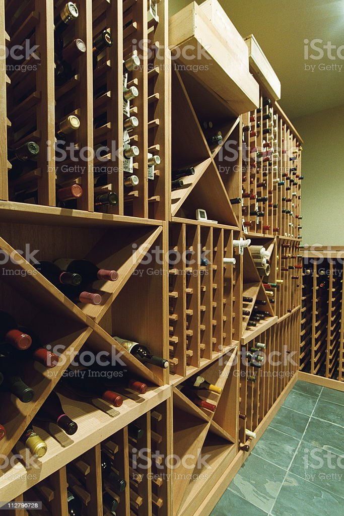 Large Wine Cellar with birch colored storage and tile floor royalty-free stock photo