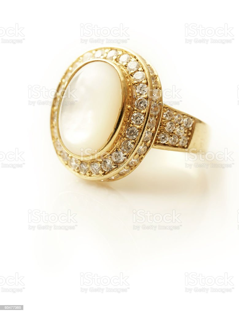 A large women's golden ring and diamonds royalty-free stock photo