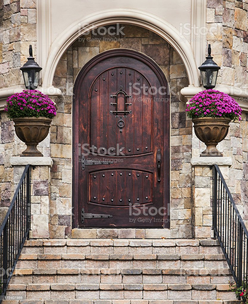 Large Wooden arched entry door royalty-free stock photo