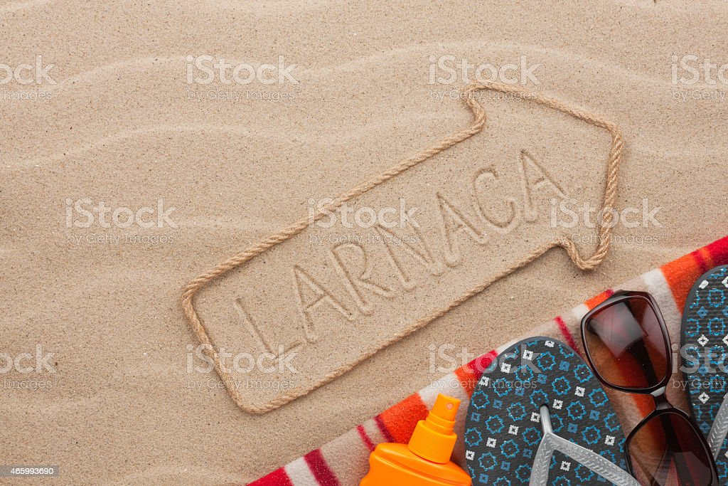 Larnaca  pointer and beach accessories lying on the sand stock photo