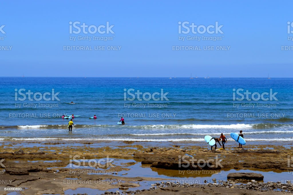 Playa De Las Americas beach surfers stock photo