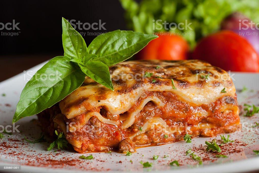 Lasagna on a square white plate stock photo