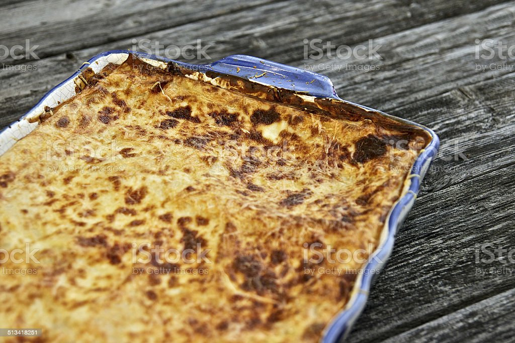 Lasagna on a wooden board stock photo