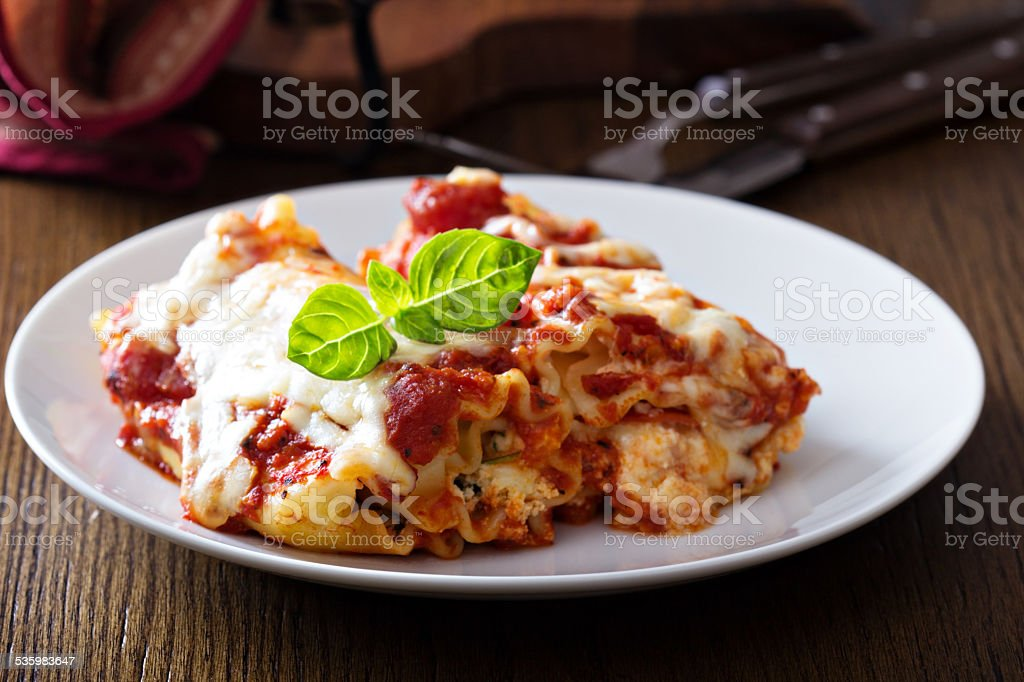 Lasagna rolls with tomato sauce stock photo