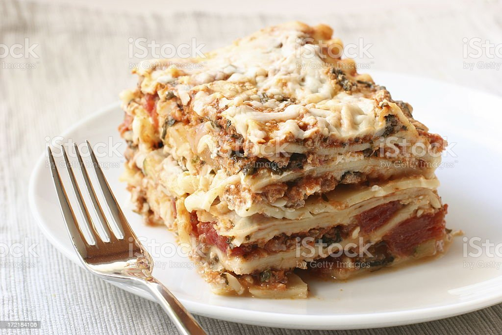 lasagna with fork stock photo