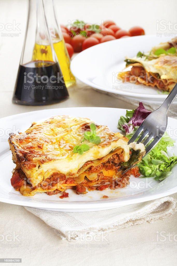 Lasagna with garnish royalty-free stock photo