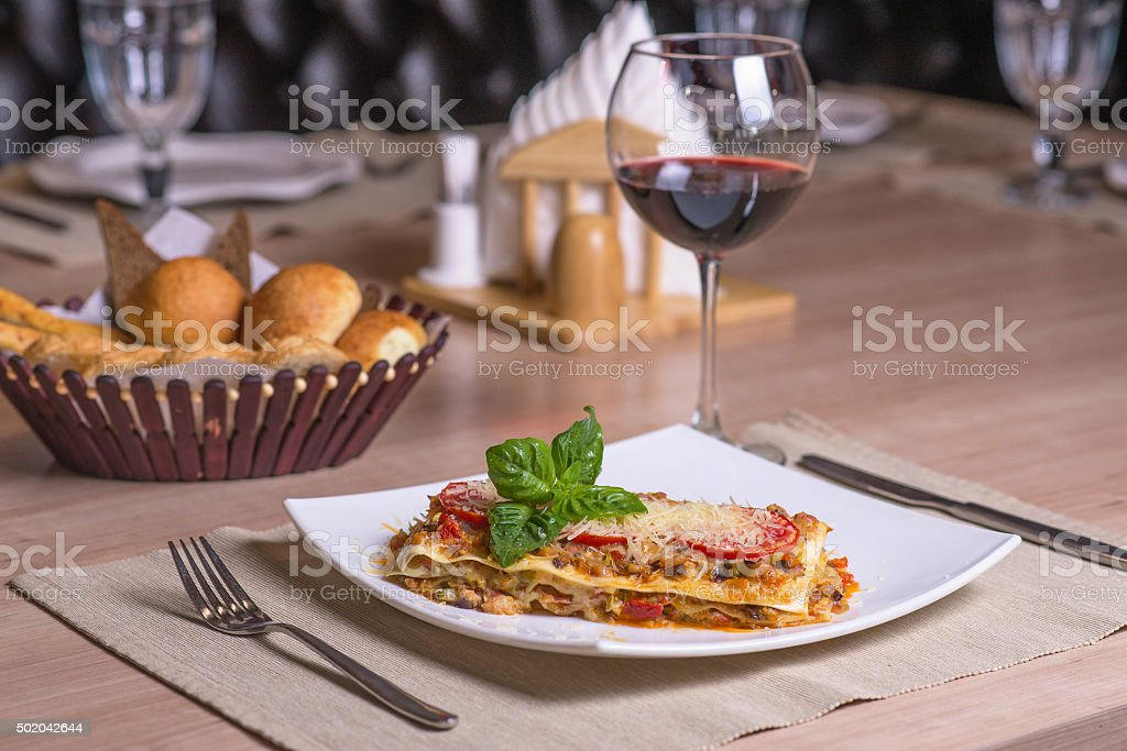 lasagna with red wine stock photo