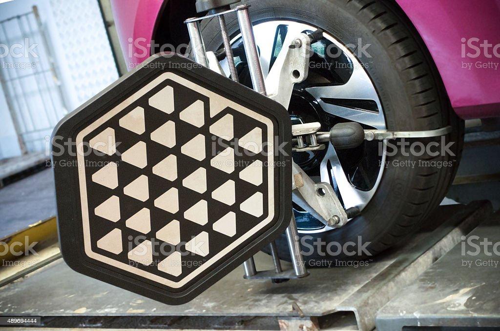 Laser computerized wheel alignment machine stock photo