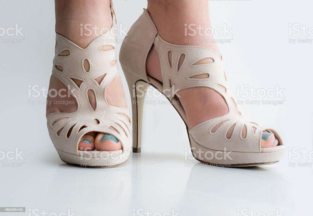 Laser cut high heel platform sandals stock photo