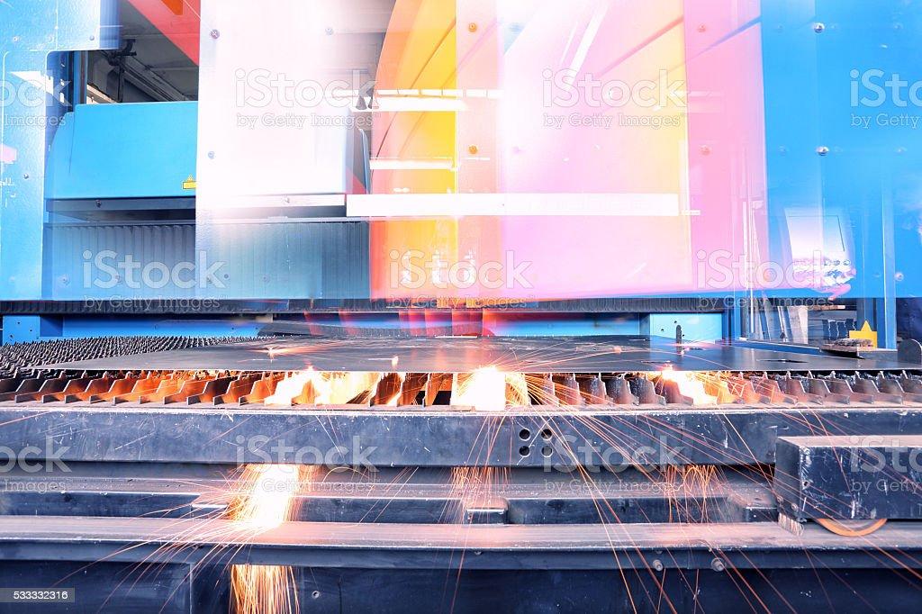 laser cutting machine in motion stock photo