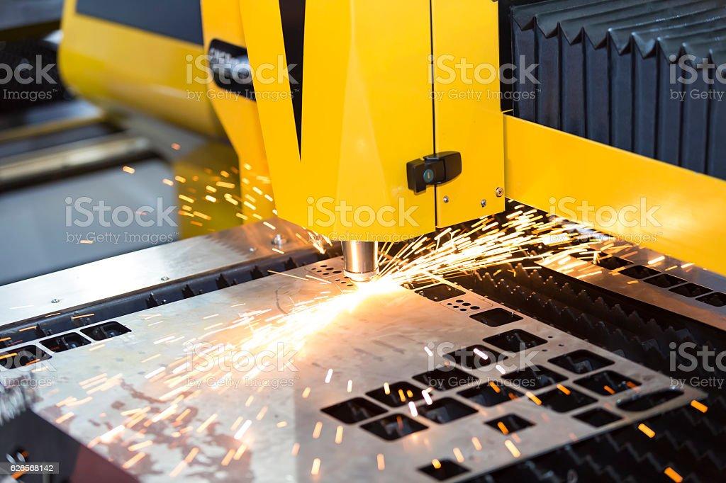 CNC laser cutting metal sheet stock photo