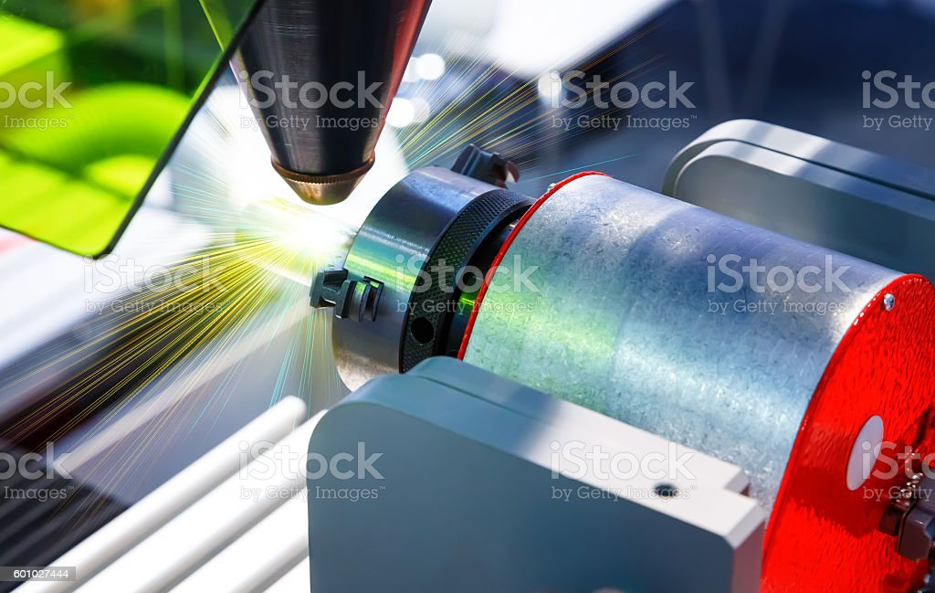 Laser cutting of metal on lathe with program. stock photo