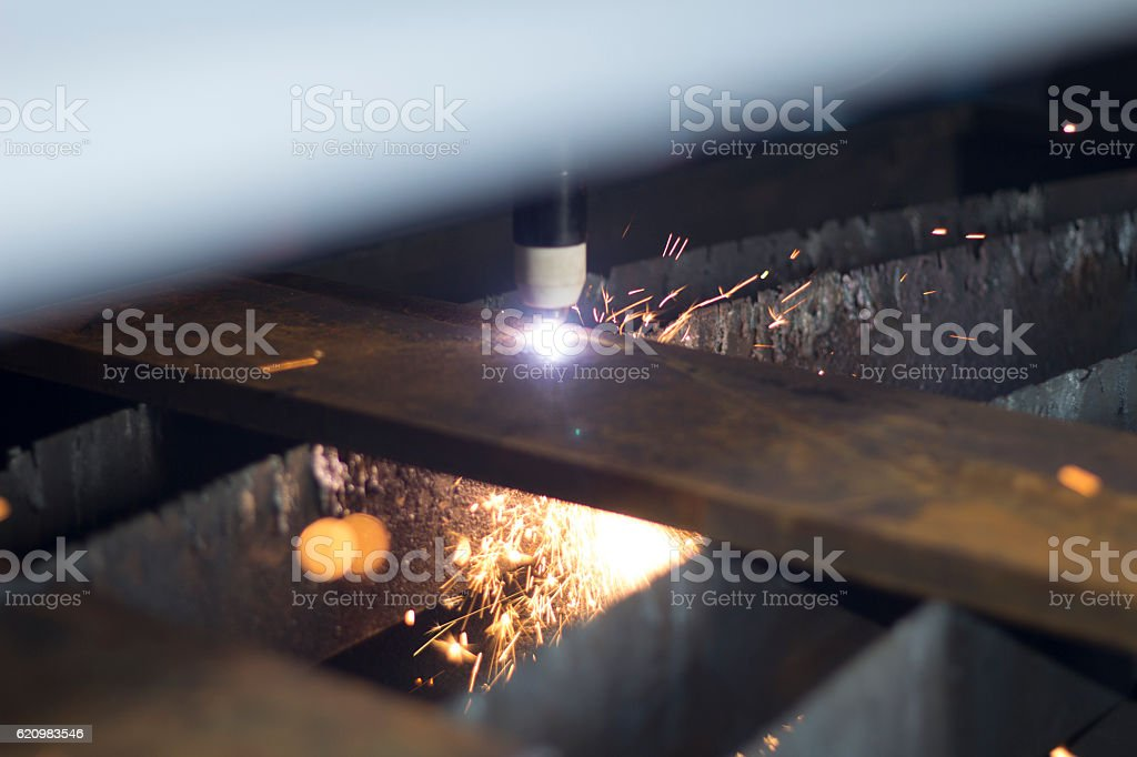 Laser cutting of metal sheet with sparks. stock photo