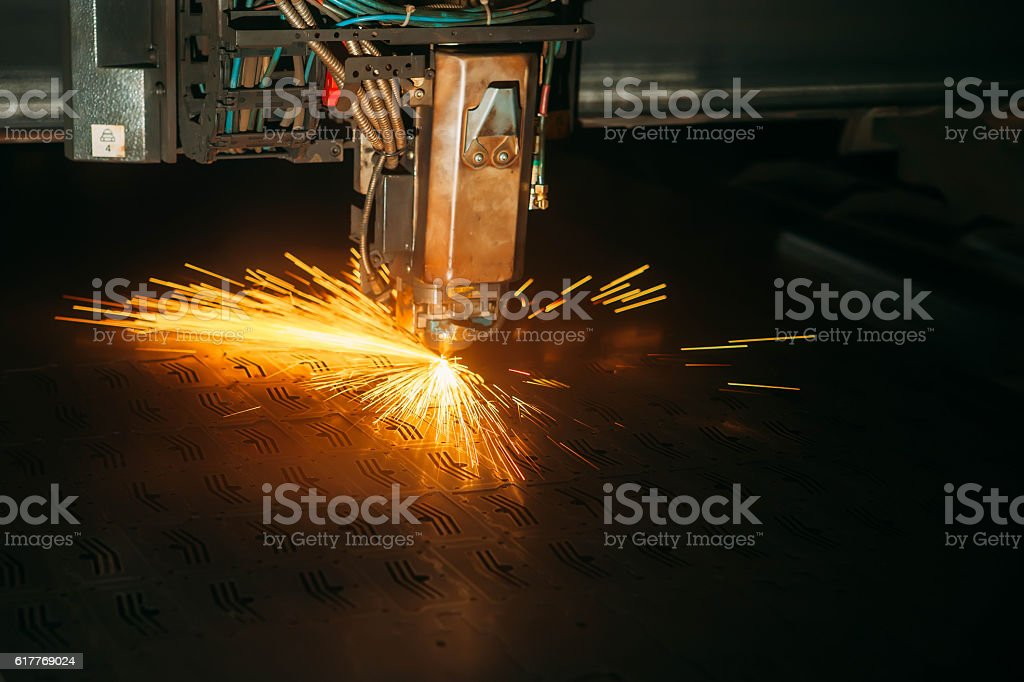 Laser cutting with sparks close up stock photo