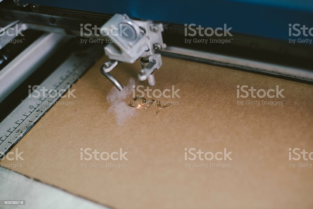 Laser engraving DIY word on recycle cardboard stock photo