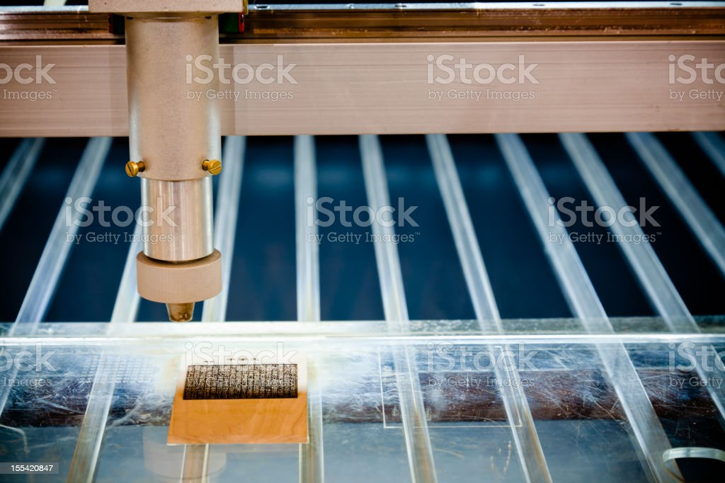 laser engraving machine cuting out text pattern stock photo