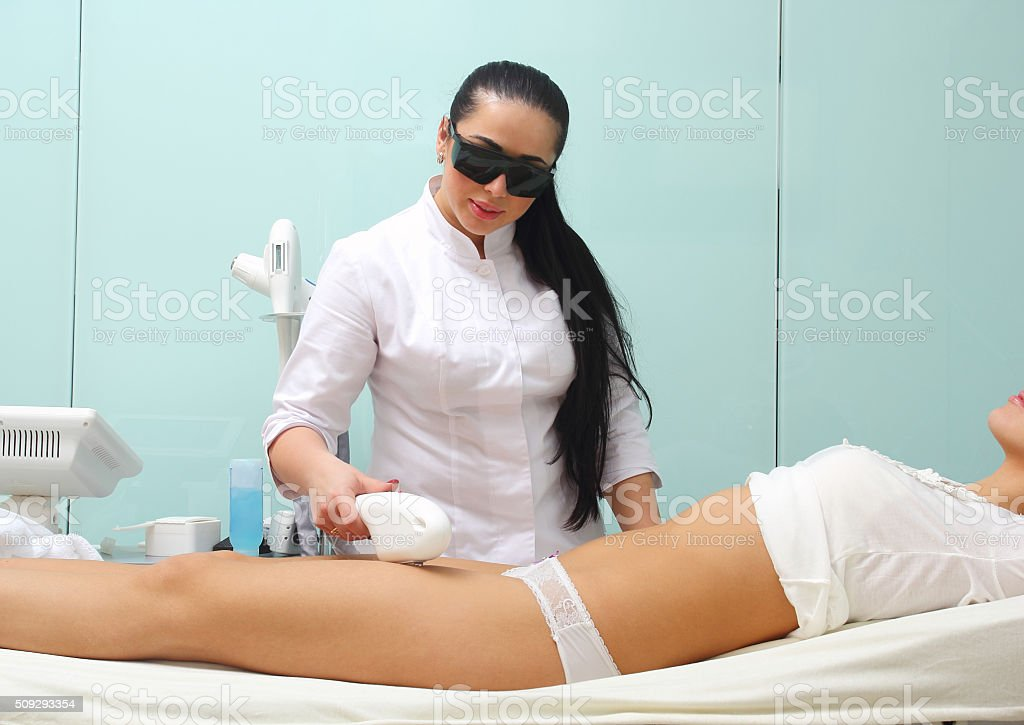 Laser hair removal on ladies legs royalty-free stock photo