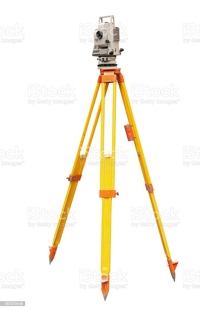 Laser level for surveying on a yellow and orange tripod stock photo