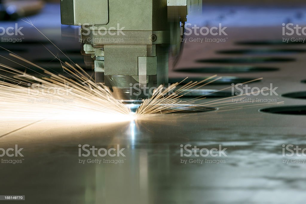 CNC laser metal cutting machine tool in operation stock photo