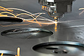 Laser metal cutting manufacturing tool in operation