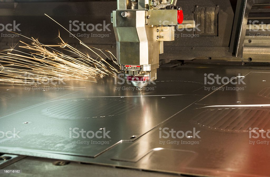 Laser metal cutting manufacturing tool in operation stock photo