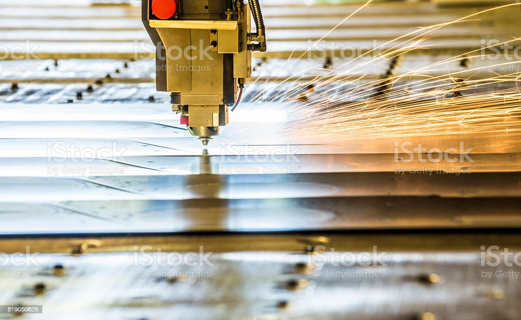 Laser metal cutting tool in a factory stock photo