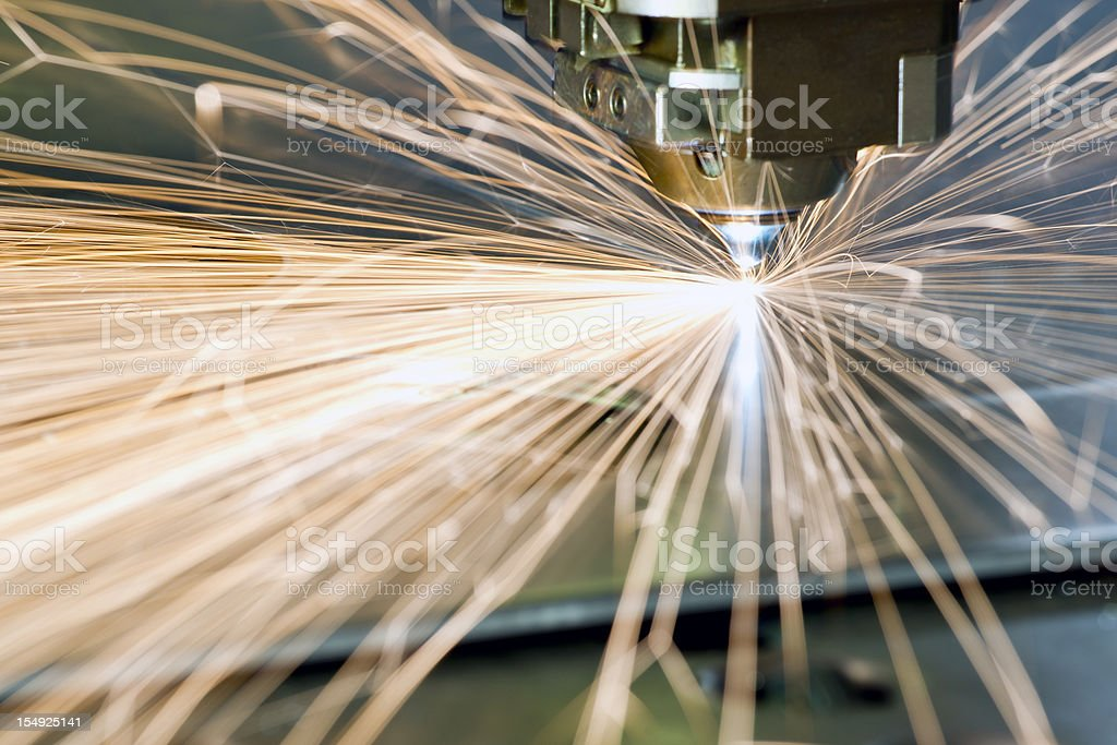 CNC laser metal-cutting manufacturing tool stock photo