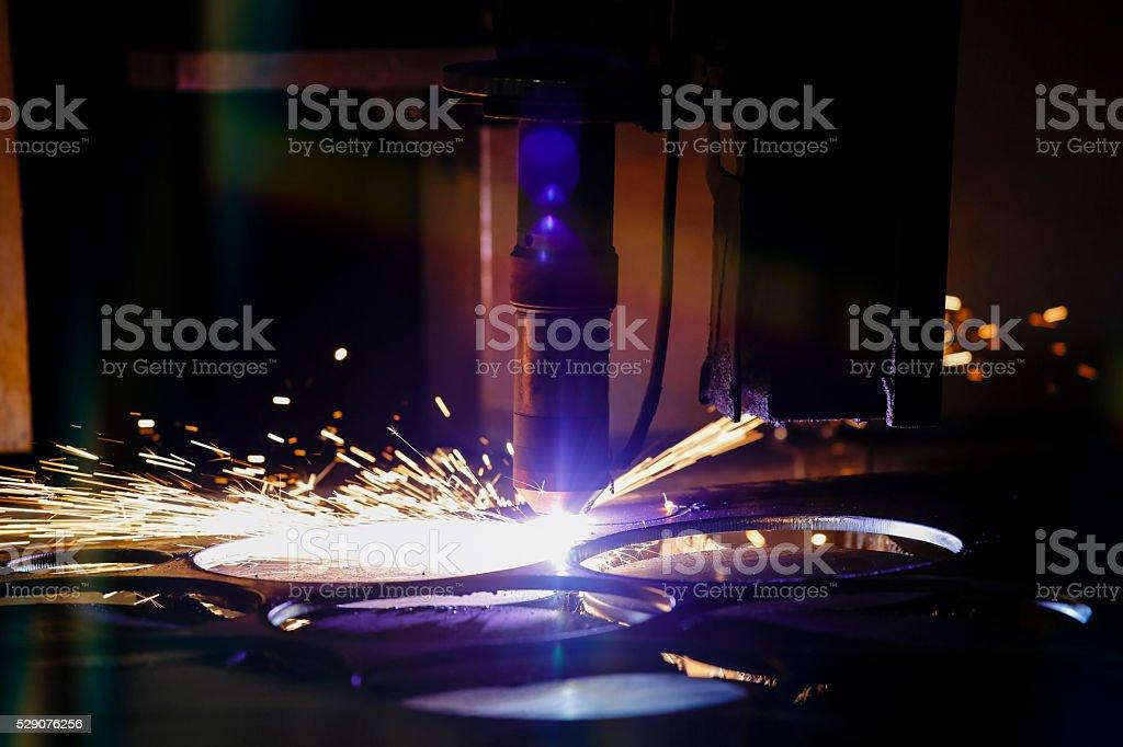 CNC laser metal-cutting manufacturing tool stock photo