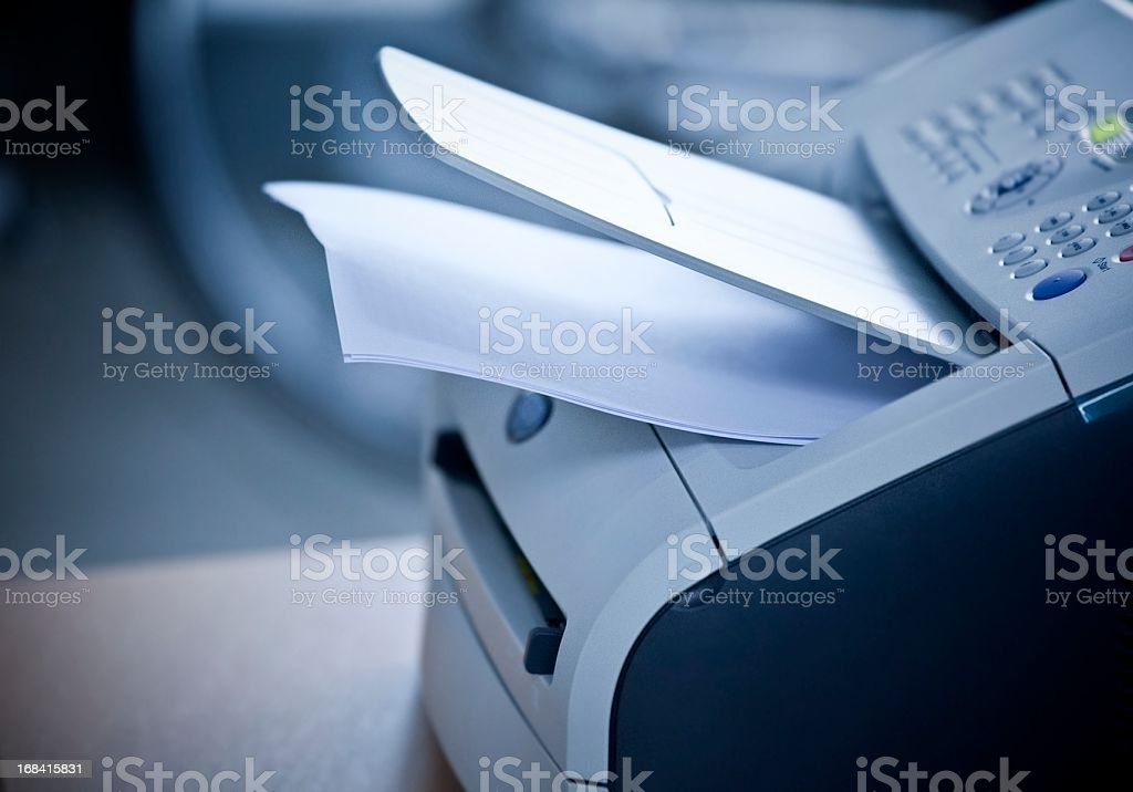Laser printer with documents in office stock photo