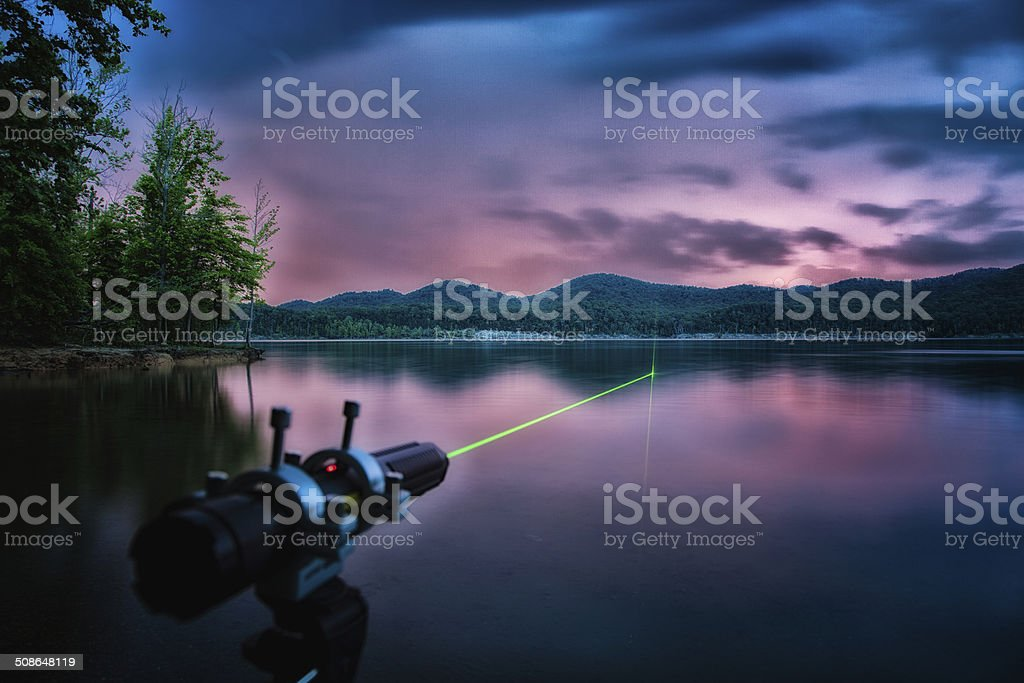 Laser Shooting Across Lake stock photo