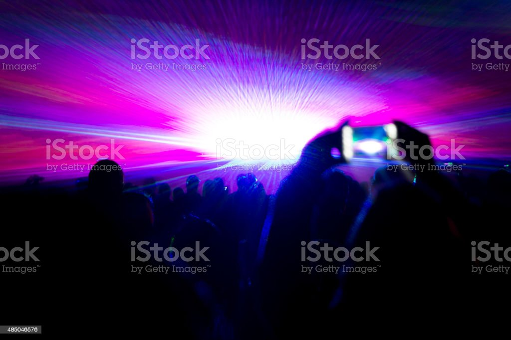 Laser show party rays in front of smartphone filming video stock photo