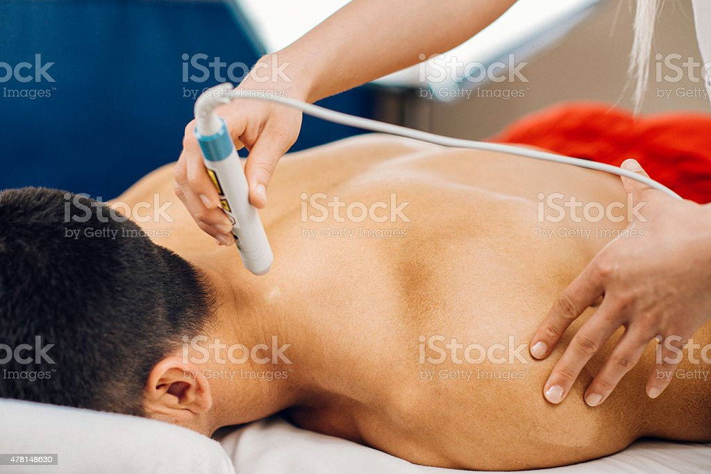 Laser treatment in physical therapy stock photo