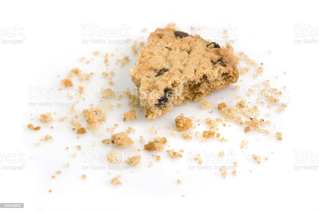 Last bite of a chocolate chip cookie stock photo