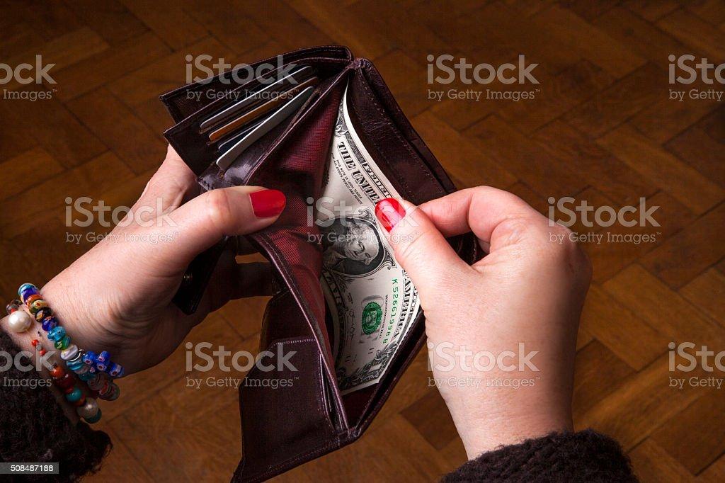 Last dollar in wallet stock photo