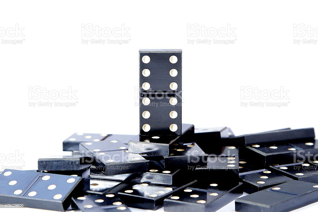 last man standing one most valuable domino leader stock photo
