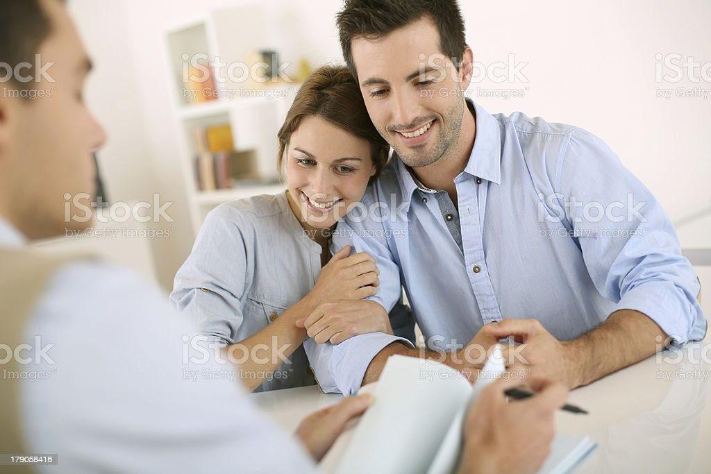 Last meeting for the architect with young couple royalty-free stock photo