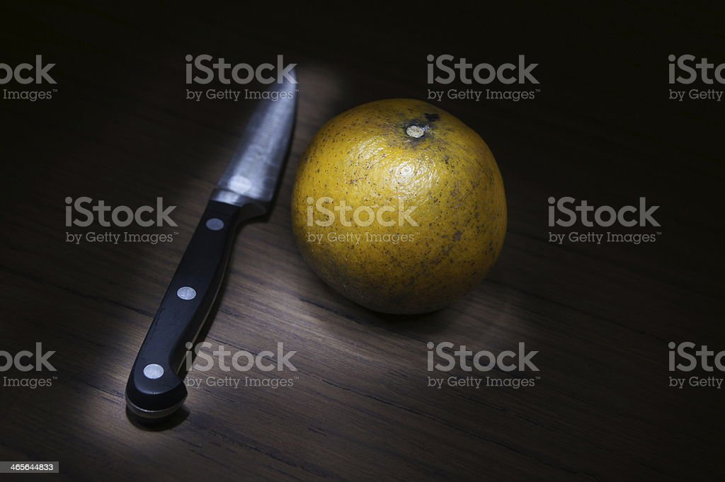 Last Orange with a knife royalty-free stock photo