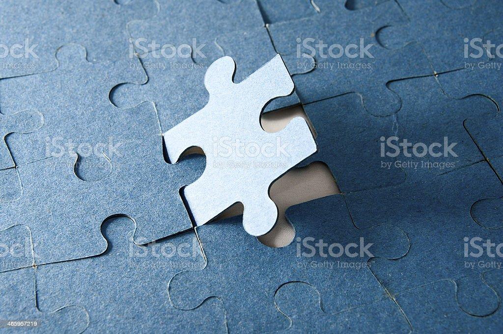 Last piece of jigsaw puzzle stock photo