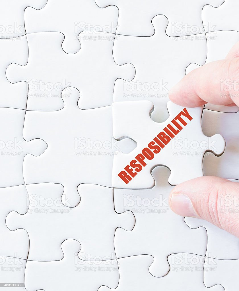 Last puzzle piece with word  RESPONSIBILITY stock photo