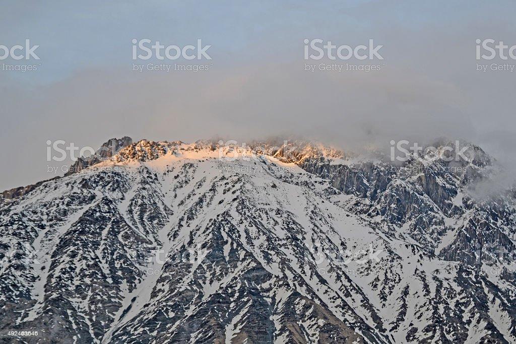 Last rays of the sun on the mountaintop, Georgia stock photo