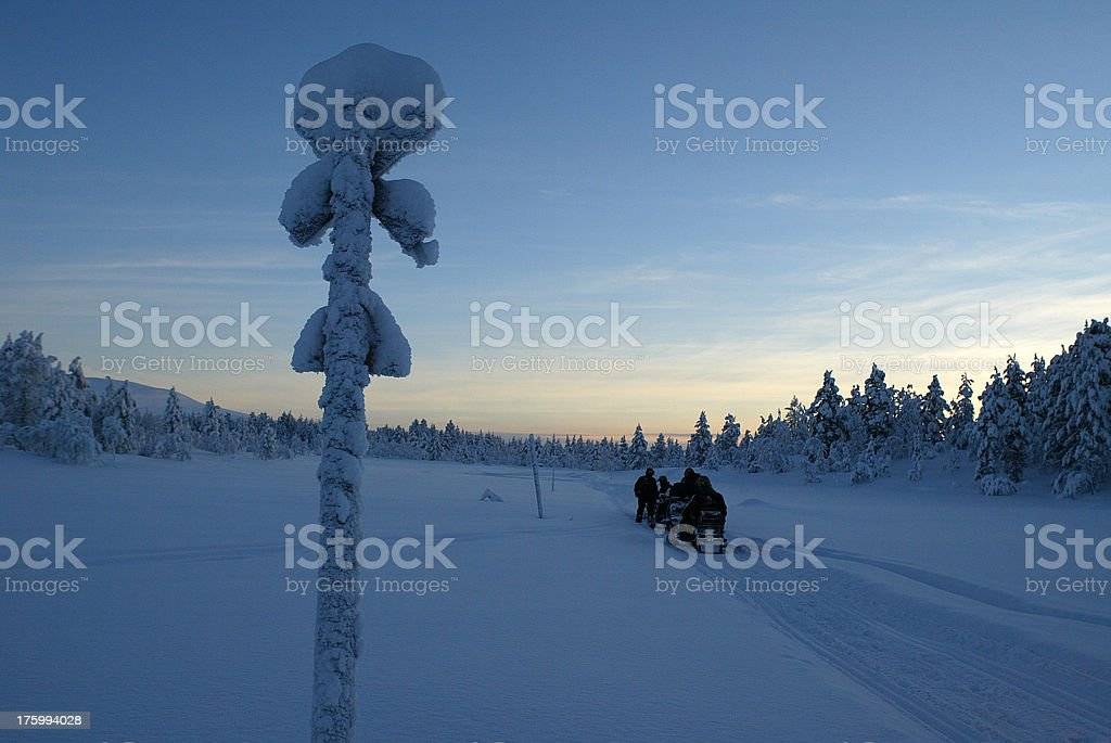 last sign snowmobile expedition royalty-free stock photo
