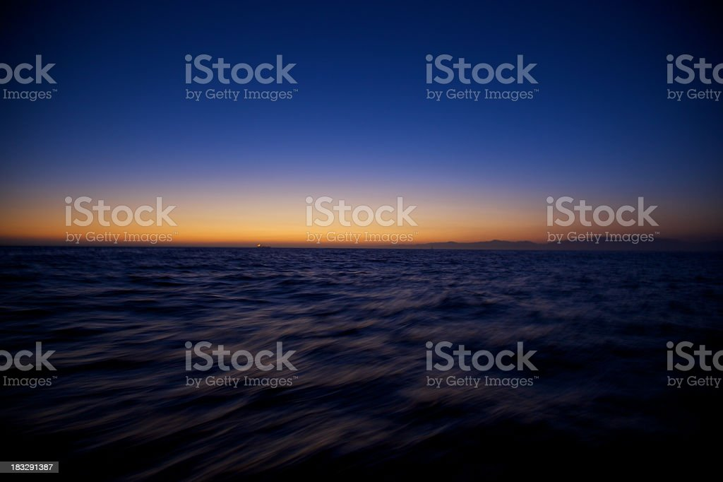 Last Speck of Light at Sunset with Motion Blur royalty-free stock photo